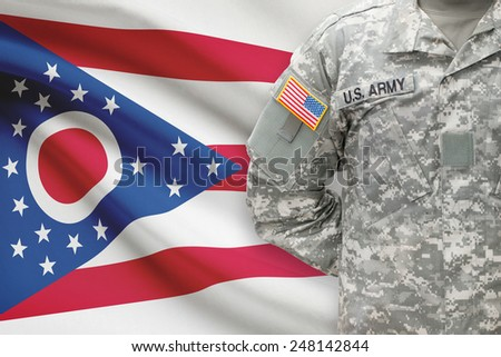 American soldier with US state flag on background - Ohio - stock photo
