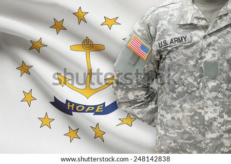 American soldier with US state flag on background - Rhode Island - stock photo