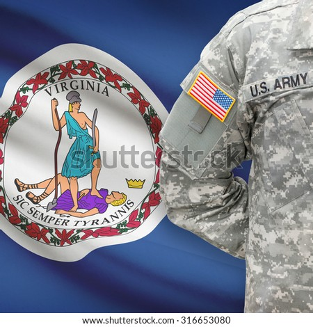 American soldier with US state flag on background series - Virginia - stock photo