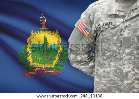 American soldier with US state flag on background - Vermont - stock photo