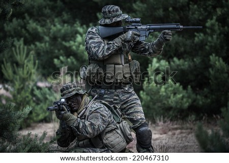 American soldiers defending their position - stock photo