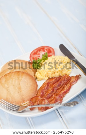 American style breakfast of pancakes, bacon and eggs - stock photo