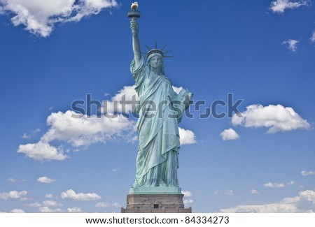American symbol - Statue of Liberty with cloudy sky. New York, USA.