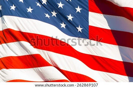 American Textile Flag Waving in the Wind. USA Flag Background.