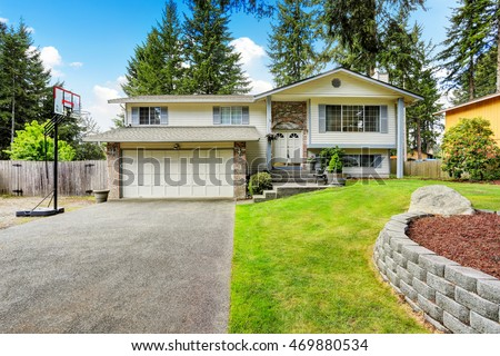 American two story house exterior with garage and double entry door.  Northwest, USA