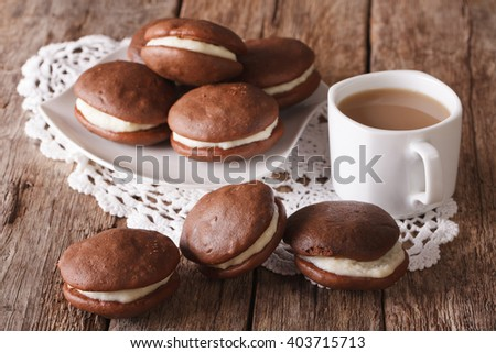 American Whoopie pie pastry and coffee with milk close-up on the table. horizontal