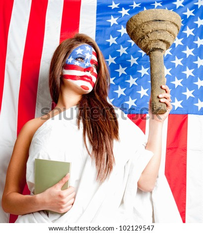 American woman dressed as the Statue of Liberty with the USA flag painted on her face