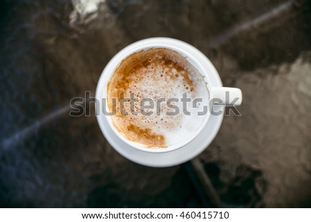 Americano coffee with hot milk. Coffee cup on table