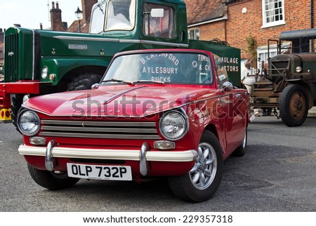 AMERSHAM, UK - SEPTEMBER 7: A classic Triumph Herald motorcar stands on public display at the annual Amersham Heritage Day show on September 7, 2014 in Amersham - stock photo