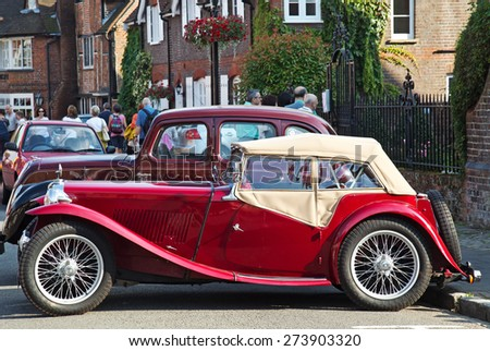 AMERSHAM, UK - SEPTEMBER 7: A classic vintage MG sports car stands on public display along the towns High Street at the annual Amersham Heritage Day show on September 7, 2014 in Amersham - stock photo