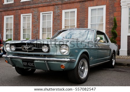 AMERSHAM, UK - SEPTEMBER 13: A vintage Mustang muscle car is parked on the side of the highway as a static display at the Amersham Heritage Day festival on September 13, 2015 in Amersham.