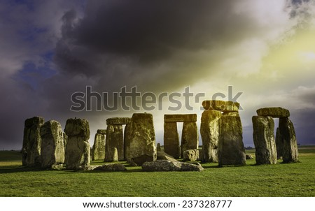 AMESBURY, UK - MARCH 03: Stonehenge, prehistoric monument, set against a foreboding sky and a blue sunny at Amesbury, Wiltshire, UK.