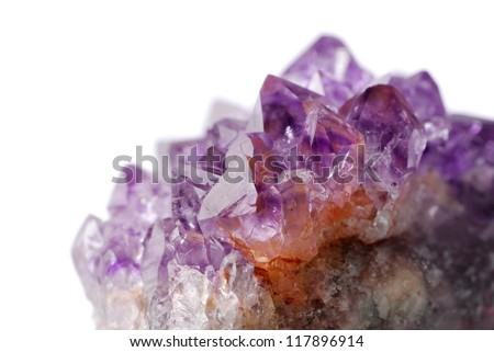 Amethyst crystal close up against white background - stock photo