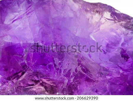 Amethyst crystal from Brazil. Closeup picture of raw unpolished rock. - stock photo