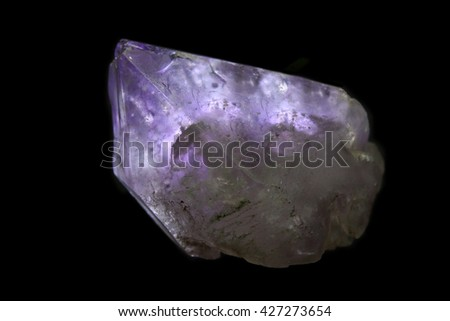 Amethyst  jewel isolated on black background - stock photo