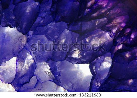 amethyst macroshot blue background closeup - stock photo