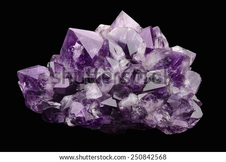 Amethyst over black background, a violet variety of quartz, often used in jewelry. Silica, silicon dioxide, SiO2. - stock photo