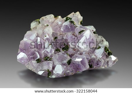 Amethyst specimen with epidot from Hongqizhen Quarry, Sichuan, China.  - stock photo