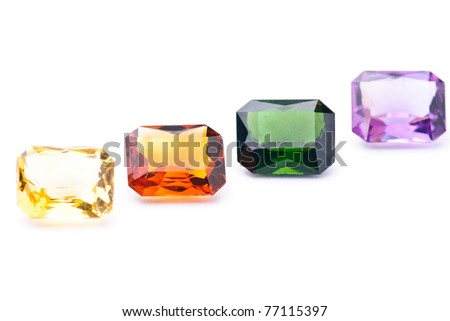 amethyst, tourmaline, citrin colorful jewels isolated against a white background - stock photo