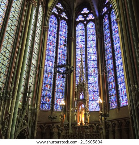 AMIENS, FRANCE - AUGUST 10, 2014: wall and stained glass window of Amiens Cathedral. The Cathedral Basilica of Amiens was built between 1220-1270 and has been listed as UNESCO World Heritage Site