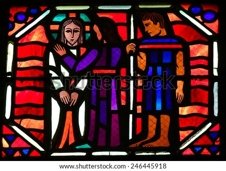 AMIENS, FRANCE - FEBRUARY 9, 2013: Stained glass window depicting Jesus being betrayed by Judas with a kiss, in the Cathedral of Our Lady of Amiens, France. - stock photo
