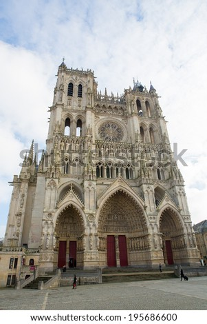AMIENS, FRANCE - FEBRUARY 9, 2013: Unidentified people walking in front of the famous Amiens Cathedral in Amiens, France.