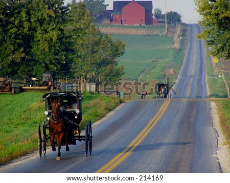 Amish buggies approaching; Mt. Eaton, Ohio - stock photo