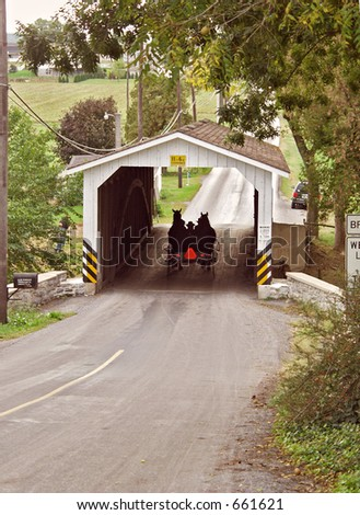 Amish on Covered Bridge - stock photo