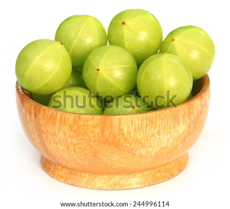 Amla fruits in a bowl over white background - stock photo