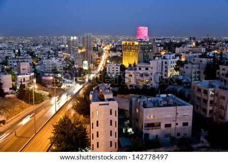 "Amman,Jordan - April 29 : City lights after the sunset on April 29,2013 in the west side of the capital ""Amman"" and Le Royal hotel with in the background"
