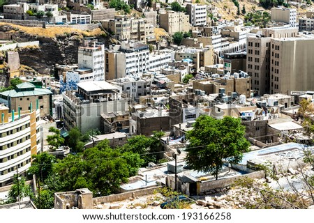 AMMAN, JORDAN - MAY 3, 2014: Cityscape of Amman. Amman is the capital and most populous city of the Kingdom of Jordan.
