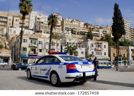 """AMMAN - JORDAN NOV 27: Police car downtown Amman on November 27, 2009 Amman, Jordan. Law enforcement in Jordan is the purview of the """"Public Security Force"""" (includes approximately 25,000 persons) - stock photo"""