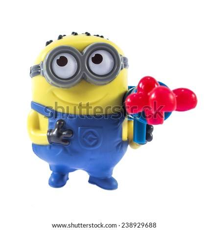 Amman, Jordan - November  1, 2014: Minion Stuart Blaster toy figure. There are plastic toy sold as part of the McDonald's Happy meals. - stock photo