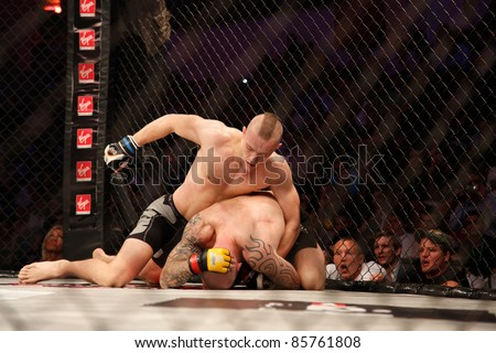 AMMAN, JORDAN - SEPTEMBER 8 : Conor Mcgregor (Top)(L) defeats Aron Jahnsen (Bottom)(R) by Knockout at 3:29 of Round 1, Cage Warriors Fight Night 2, Fight Card on September 8, 2011 in Amman, Jordan - stock photo