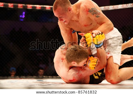 AMMAN, JORDAN - SEPTEMBER 8 : Jack Hermansson (Right)(Top) defeats Mike Ling (Left)(Bottom) by Knockout at 3:30 of Round 1,Cage Warriors Fight Night 2, Fight Card on September 8, 2011 in Amman, Jordan - stock photo