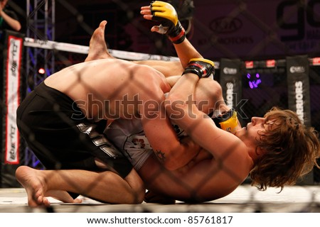 AMMAN, JORDAN - SEPTEMBER 8 : James Saville (Bottom) defeats Zac Stratton (Top) by Submission at 0:46 of Round 1, Cage Warriors Fight Night 2, Fight Card on September 8, 2011 in Amman, Jordan - stock photo