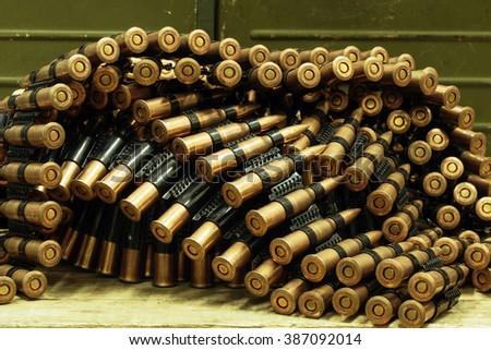 ammo to machine guns as background - stock photo