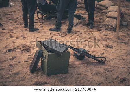 Ammunition box and machine gun - stock photo