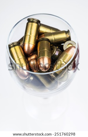 Ammunition in a wine glass.