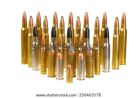 Ammunition of various types and sizes from 320 Auto to 300 Win Mag, arranged in the form of a triangle, isolated on white - stock photo