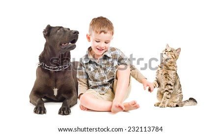Among friends. Happy boy, dog and cat sitting together. - stock photo