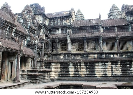 Among the restored stone temple ruins at Angkor Wat in Siem Reap, Cambodia - stock photo