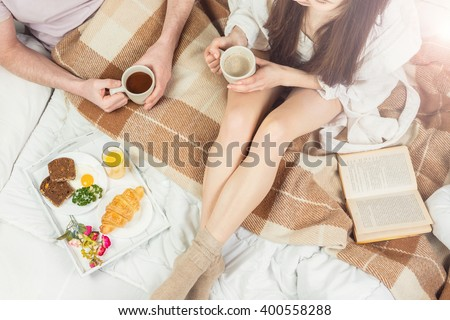 amorous couple having breakfast in bed. Light snacks good morning mood. start a new day together. top view - stock photo