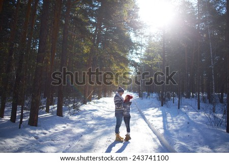 Amorous couple having romantic date in winter forest - stock photo