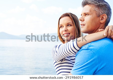 Amorous couple having romantic vacation by the sea