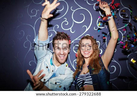 Amorous young couple dancing in night club - stock photo