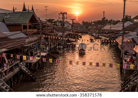 AMPHAWA,THAILAND-DECEMBER 30: Community settlement along Amphawa canal, 110 km from Bangkok, most famous floating market and cultural tourist destination on December 30, 2015 in Amphawa, Thailand.