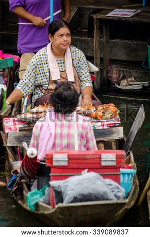 Amphawa, Thailand, 10 October 2015: A view of the famous floating markets where people sell food and goods on their boat