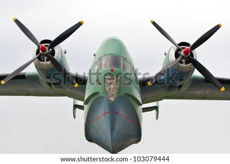 Amphibious turboprop plane on takeoff on sky background - stock photo