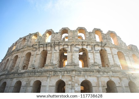 Amphitheater in El Djem from outside. Completed part with arches of roman biggest amphitheater in africa in El Djam, Tunisia - stock photo